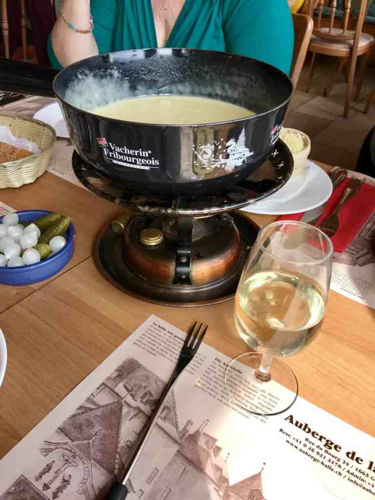 Amazing fondue in Gruyeres, Switzerland...how to plan your trip and why you have to visit Switzerland's most beautiful town. An easy day trip from Geneva!