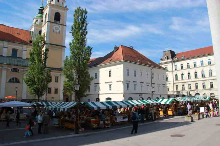 Central Market in Ljubljana, Slovenia is one of the biggest farmers markets I've ever seen! It's a great way to explore this gorgeous, vibrant city. What to do in Ljubljana, tips for your trip to Slovenia!