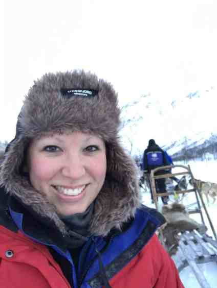 My sweet fur hat kept me warm in the Arctic...even while dog sledding!