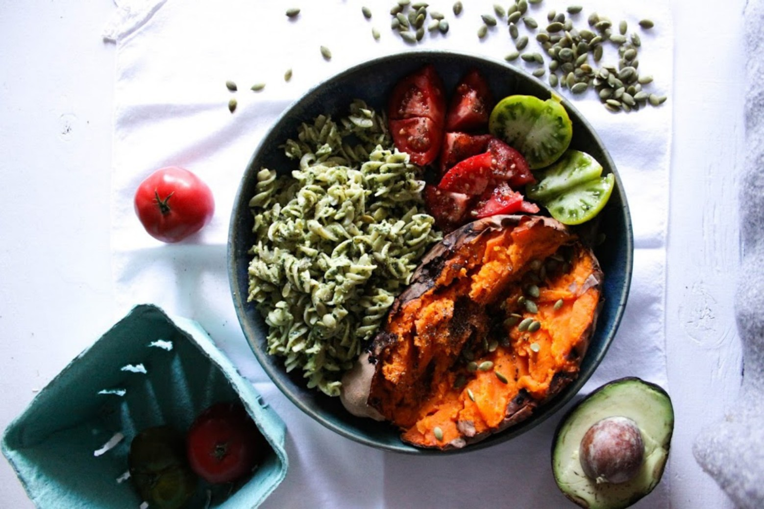 Baked Sweet Potato With Pesto Pasta, Tomatoes, and Pumpkin Seeds