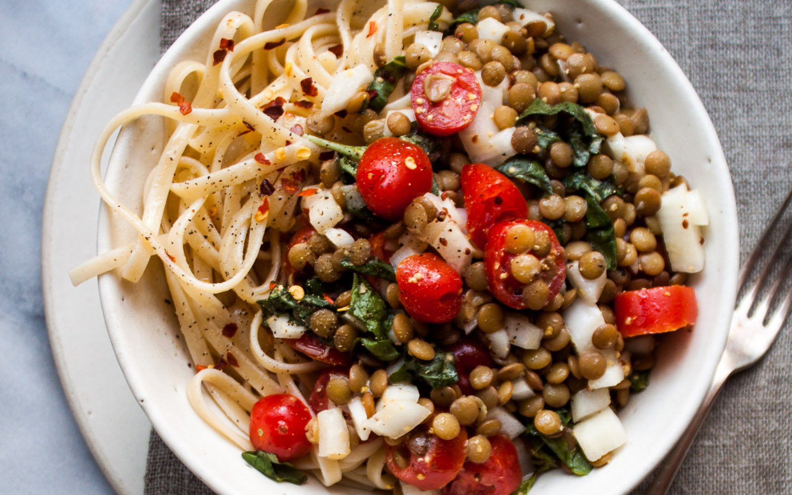 tomato and lentils over pasta