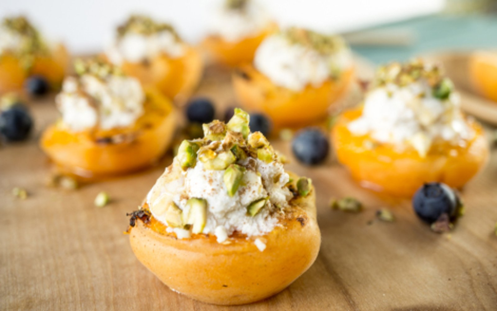 vegan grilled apricot with almond pistachio ricotta