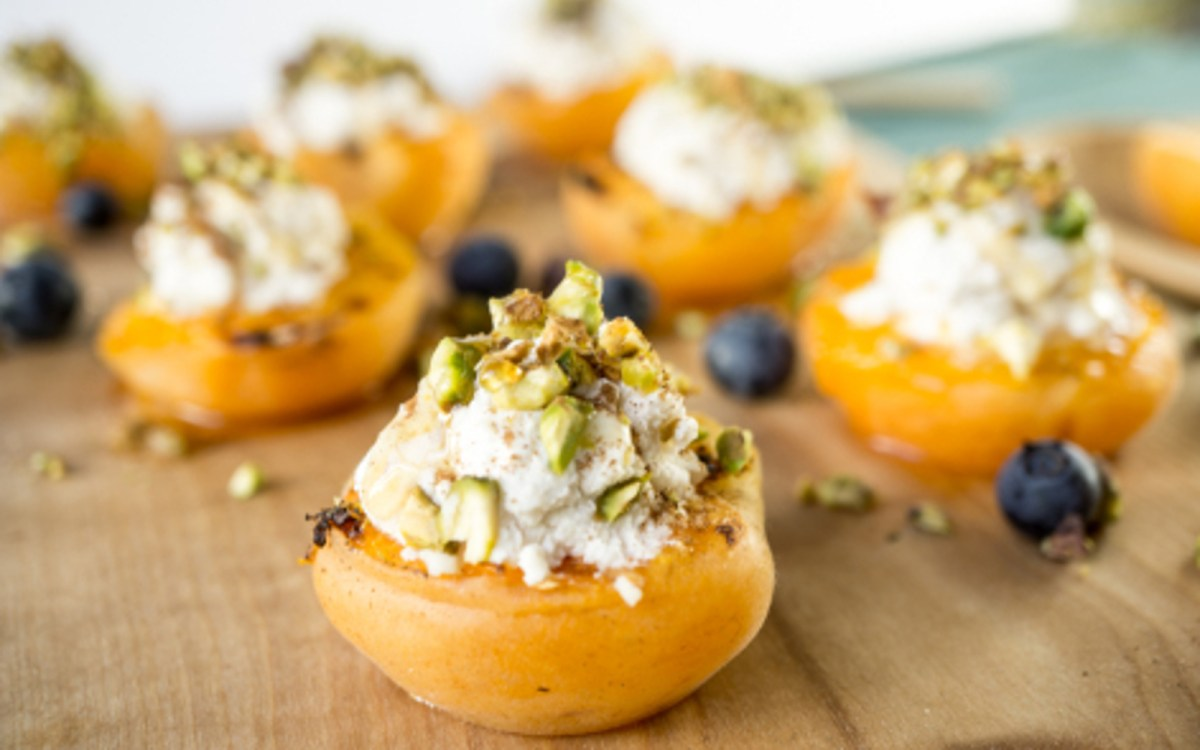 vegan grilled apricot with almond pistachio ricotta