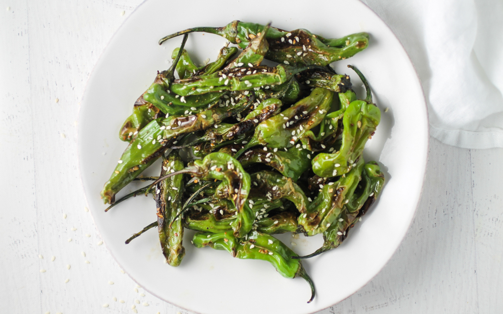 Blistered Sesame Garlic Shishito Peppers