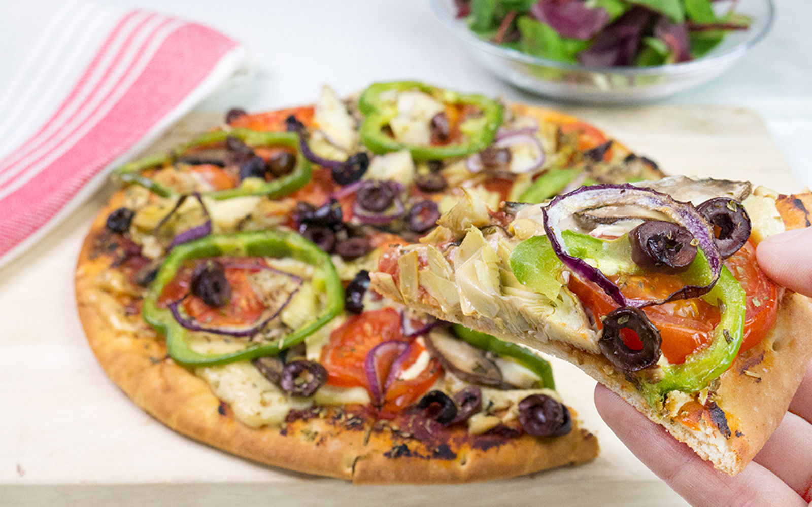 Cashew Cheese Pizza With Peppers Mushrooms and Artichokes