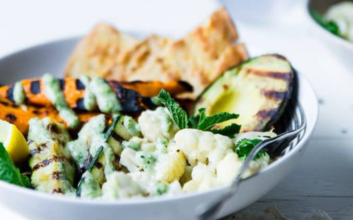 Grilled Avocado, Cauliflower, and Sweet Potato Power Bowl With Tahini Dressing