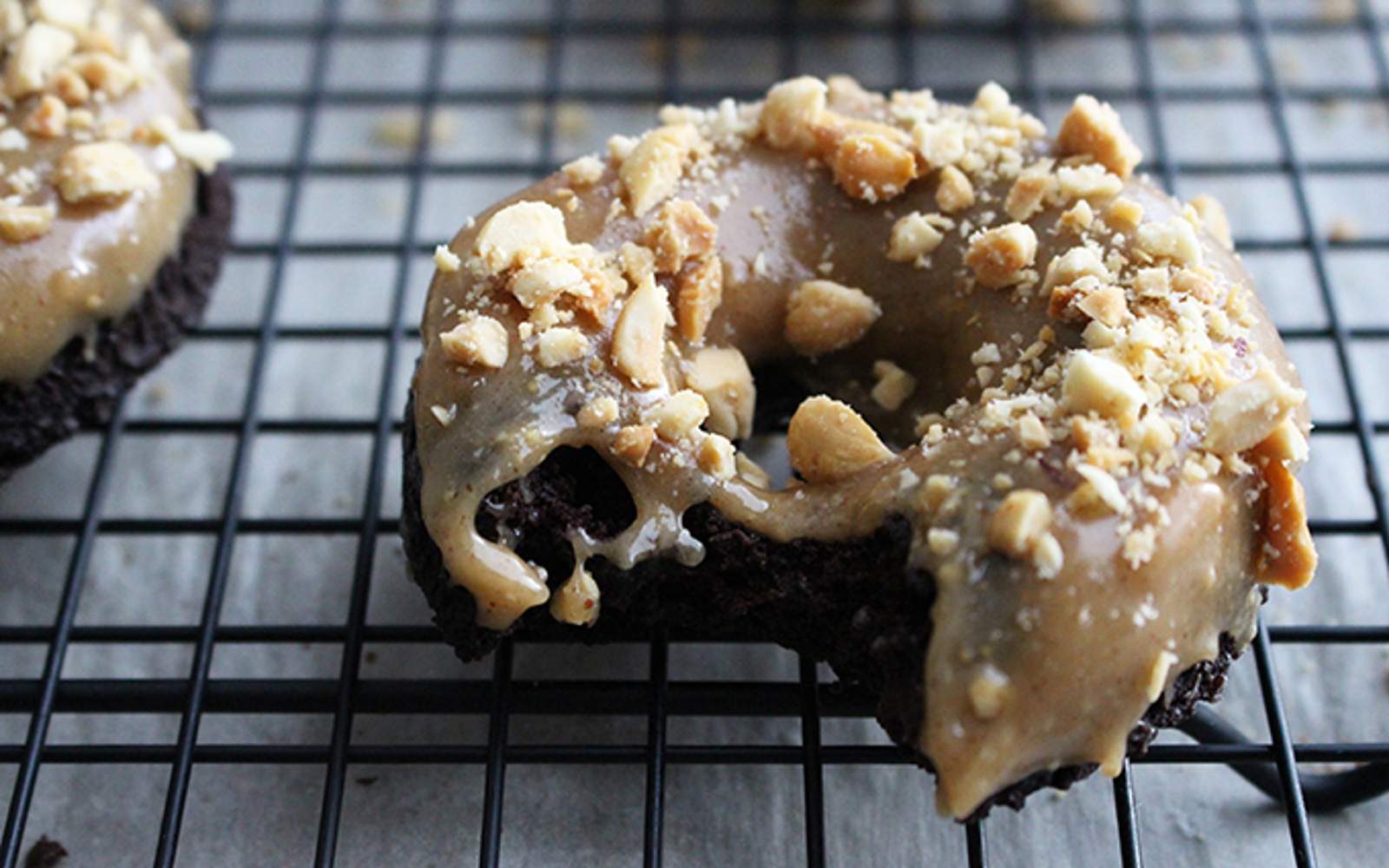 Vegan Chocolate Doughnuts With Peanut Butter Glaze with nuts