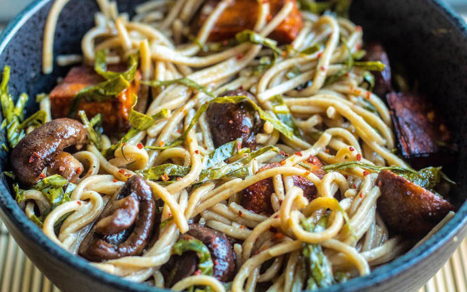 vegan stir-fried soba noodles with sweet potato and collard greens