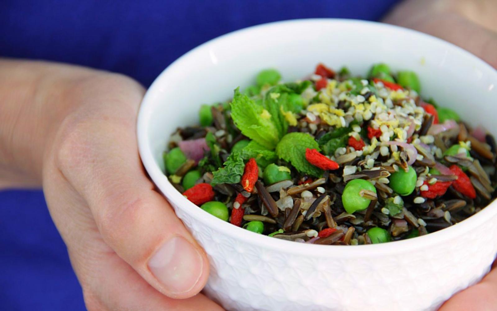 Vegan Gluten-Free Goji and Wild Rice Bowl mixed together with garnish