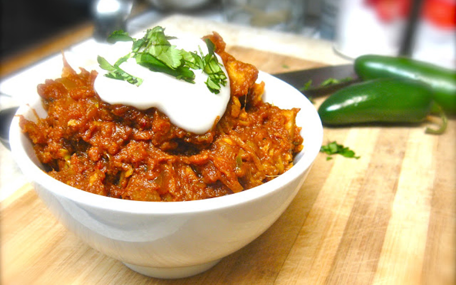 Vegan grain-free ndian Spiced Pumpkin and Jackfruit Chili topped with vegan cream
