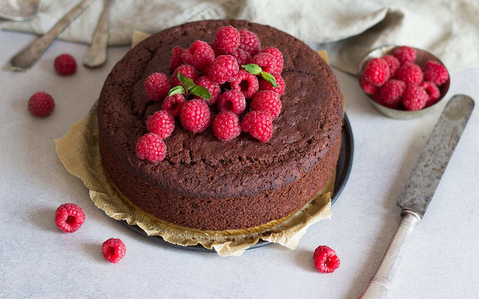Vegan Gluten-Free Chocolate Sponge Cake Topped with Raspberries