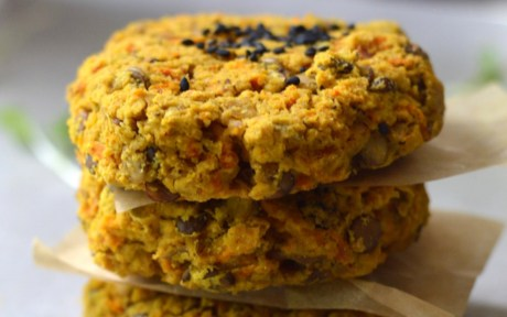 Vegan gluten-Free Curry Lentil Patties stacked with sesame seeds