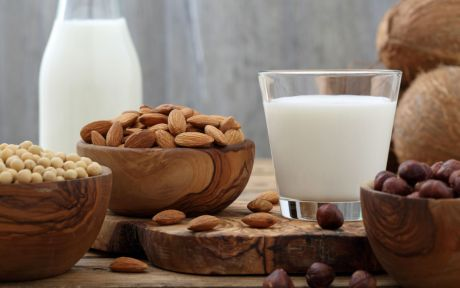 Vegan milk and nuts on a table