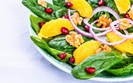 Vegan kale, orange, pomegranate, onion detox salad