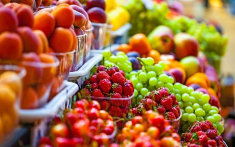 Assorted fruit in produce section of grocery