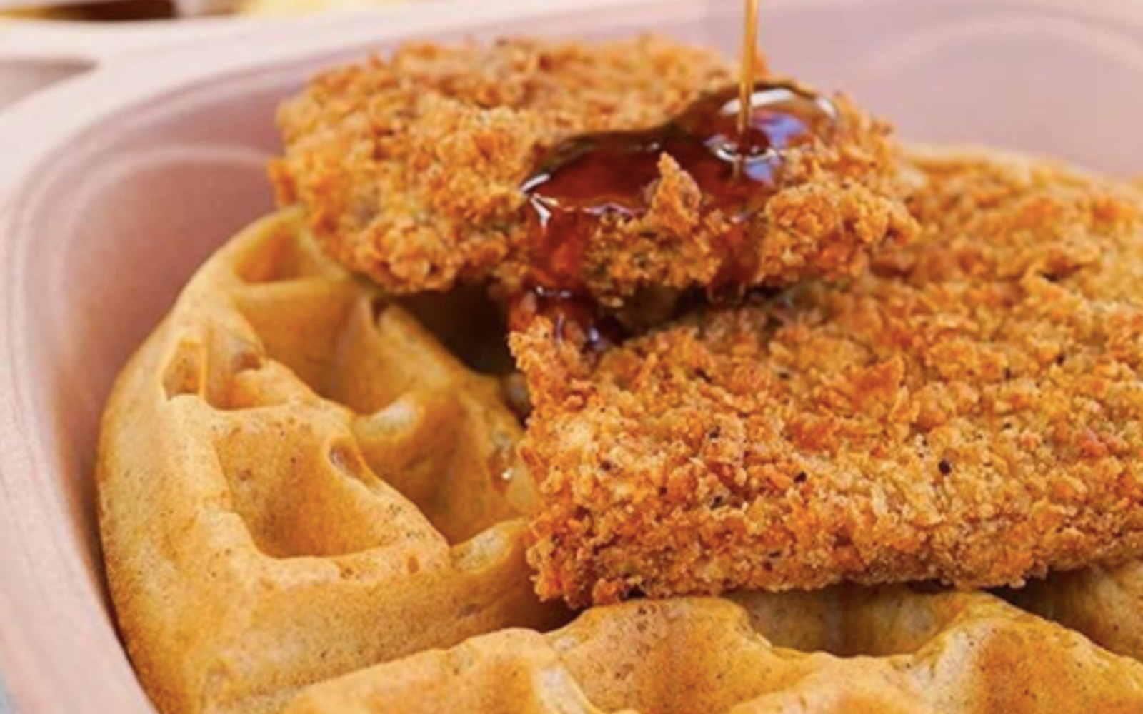 Vegan chicken and waffles with maple syrup