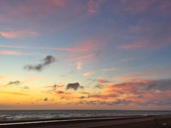 zonsondergang Bloemendaal strandhuisjes