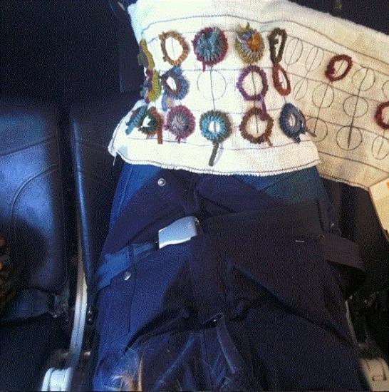 rug hooking in lap
