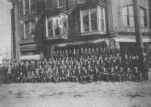 Employees of Powell & Goldstein (c. 1920) The employees of Powell & Goldstein's Cigar Factory take time out of their ten-hour work day to pose for a picture. The company was located on the corner of Madison and Main streets above what is now Napoleon's cafe. The cigar business was eventually sold off in 1943. (Courtesy Madison County Historical Society, #00.1468)