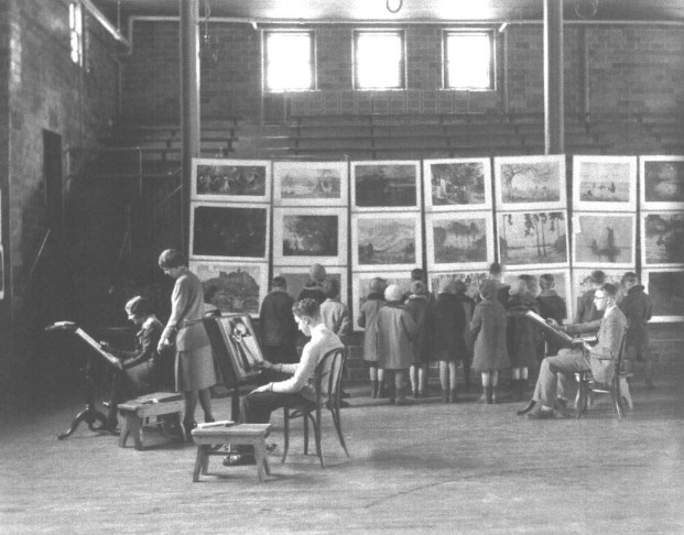 Art Class at Oneida High School (c. 1930) An art class paints while younger students observe their work in the new Oneida High School gymnasium, located at 452 Elizabeth Street. (Courtesy Madison County Historical Society, #88.45)
