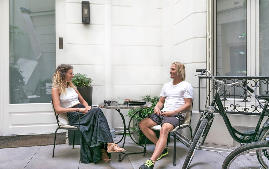 couple sitting at a table outdoors in paris
