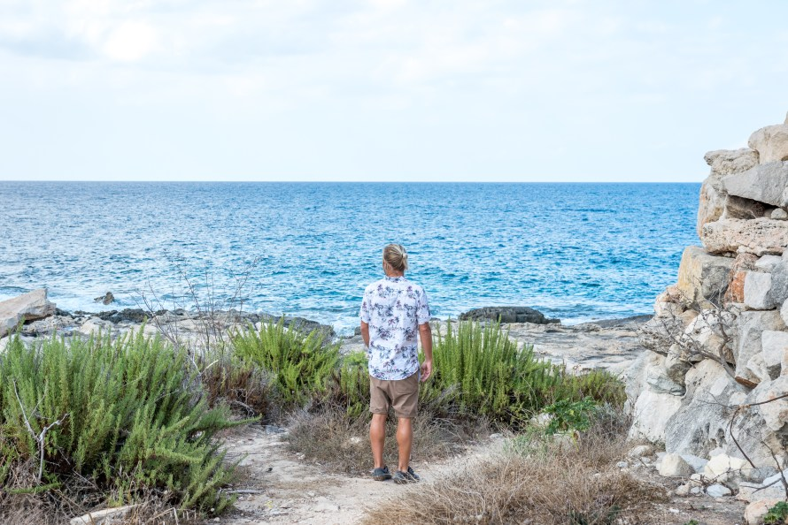 man standing staring at the Mediterranean sea