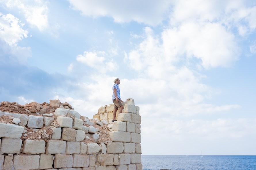 man standing on ruins in Malta