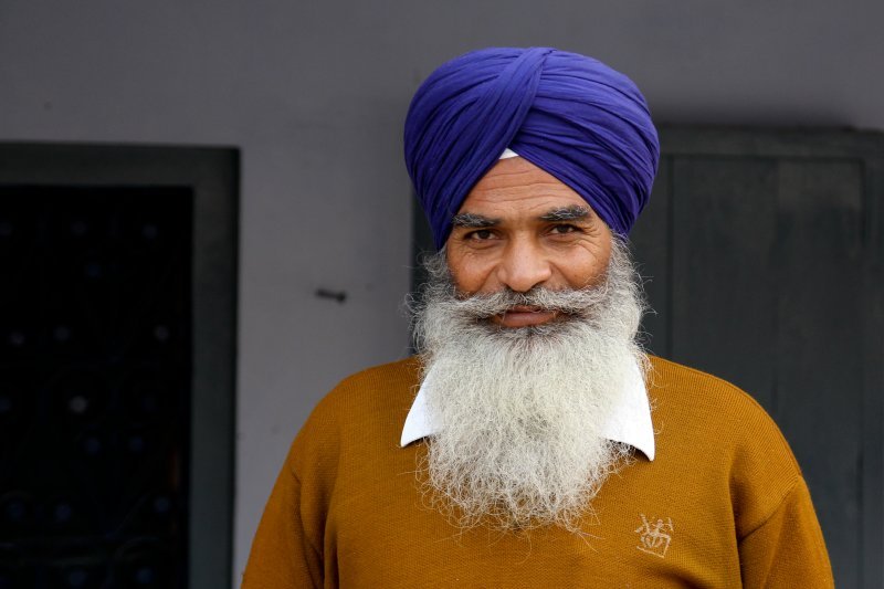 The Sikhs wear turbans and long beards
