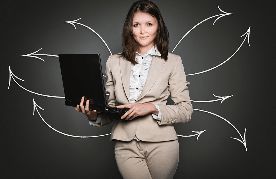 girl in a suit with a laptop