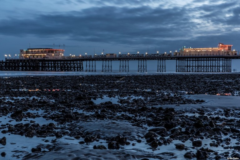 Worthing Pier: Low Tide Reflections in the Blue Hour.
