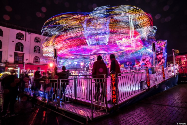 Fairground Ride: A multitude of coloured light trails.