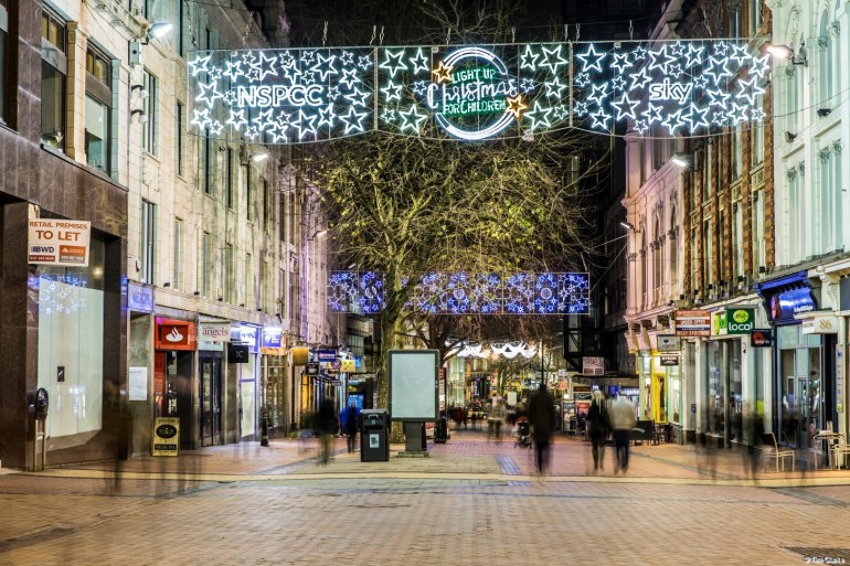 Birmingham New Street: Christmas decorations and shoppers.