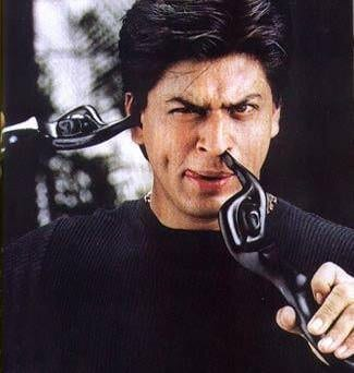 Shah Rukh Khan with his Filmfare Awards in 1998