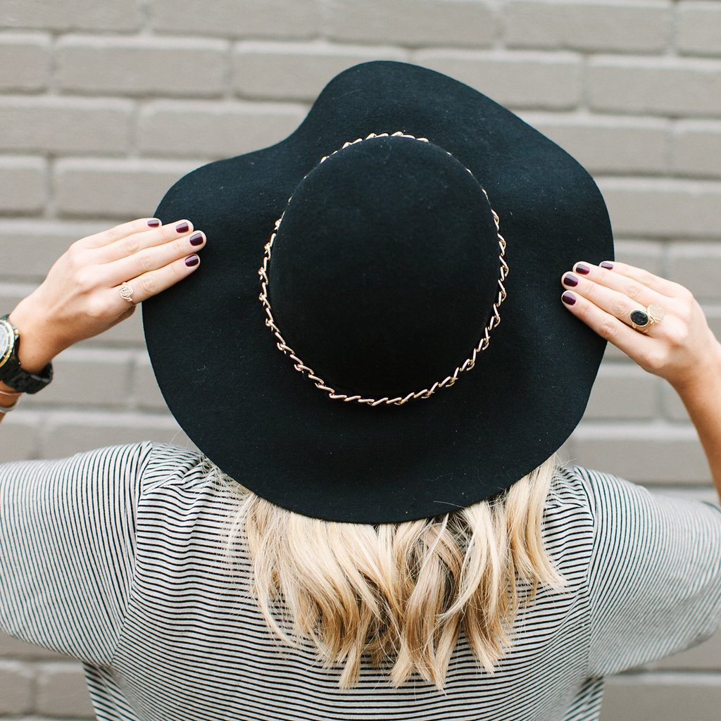 black floppy hat and striped t shirt