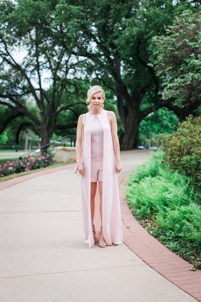 e62e954c3e65 pink romper with long cape overlay-garden party outfit idea-dallas fashion  blogger