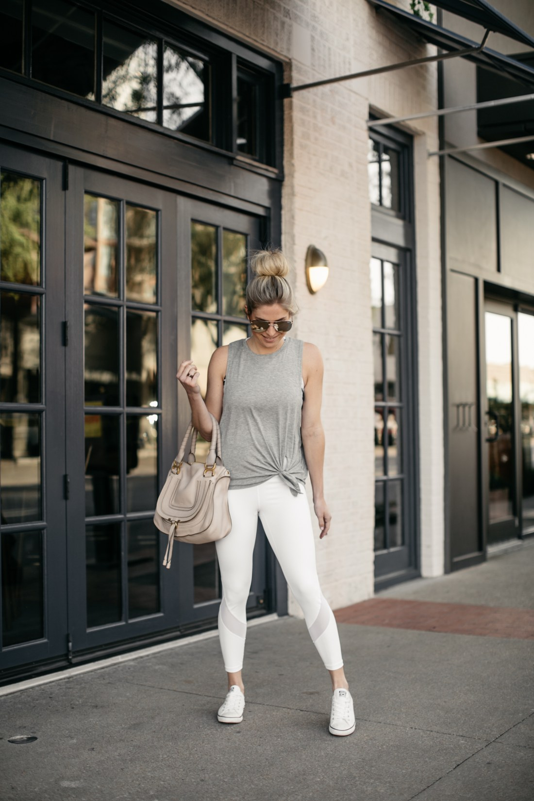 trendy white mesh leggings worn with racerback tank
