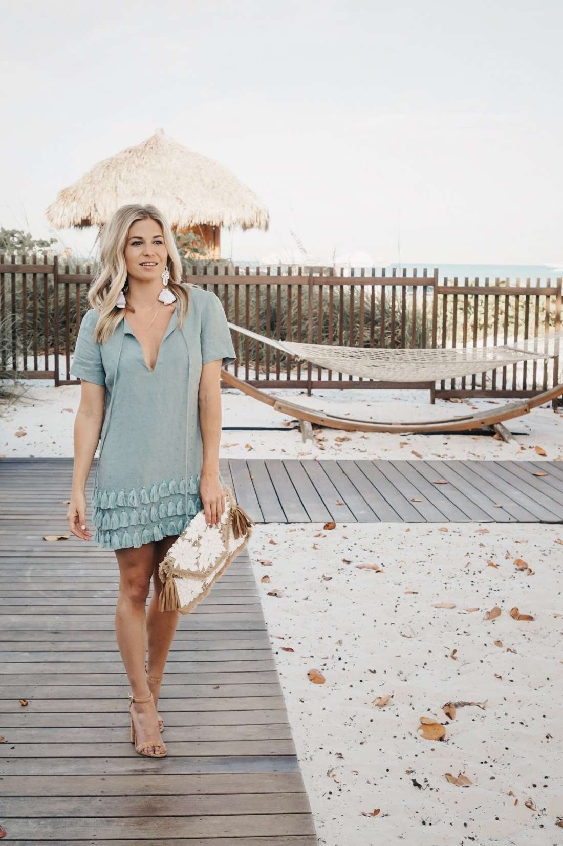 light blue shift dress, white statement earrings and summer clutch