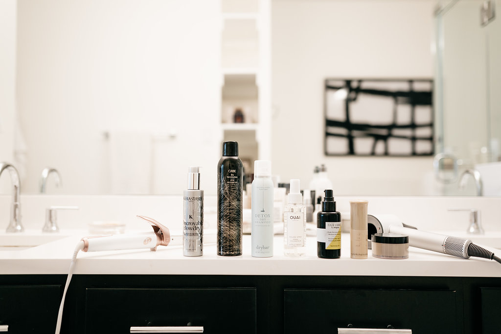 Ouai Volume Spray, Sisley Hair Oil, Balmain Hair Clay, Oribe Volume Powder, and Drybar Dry Shampoo - One Small Blonde