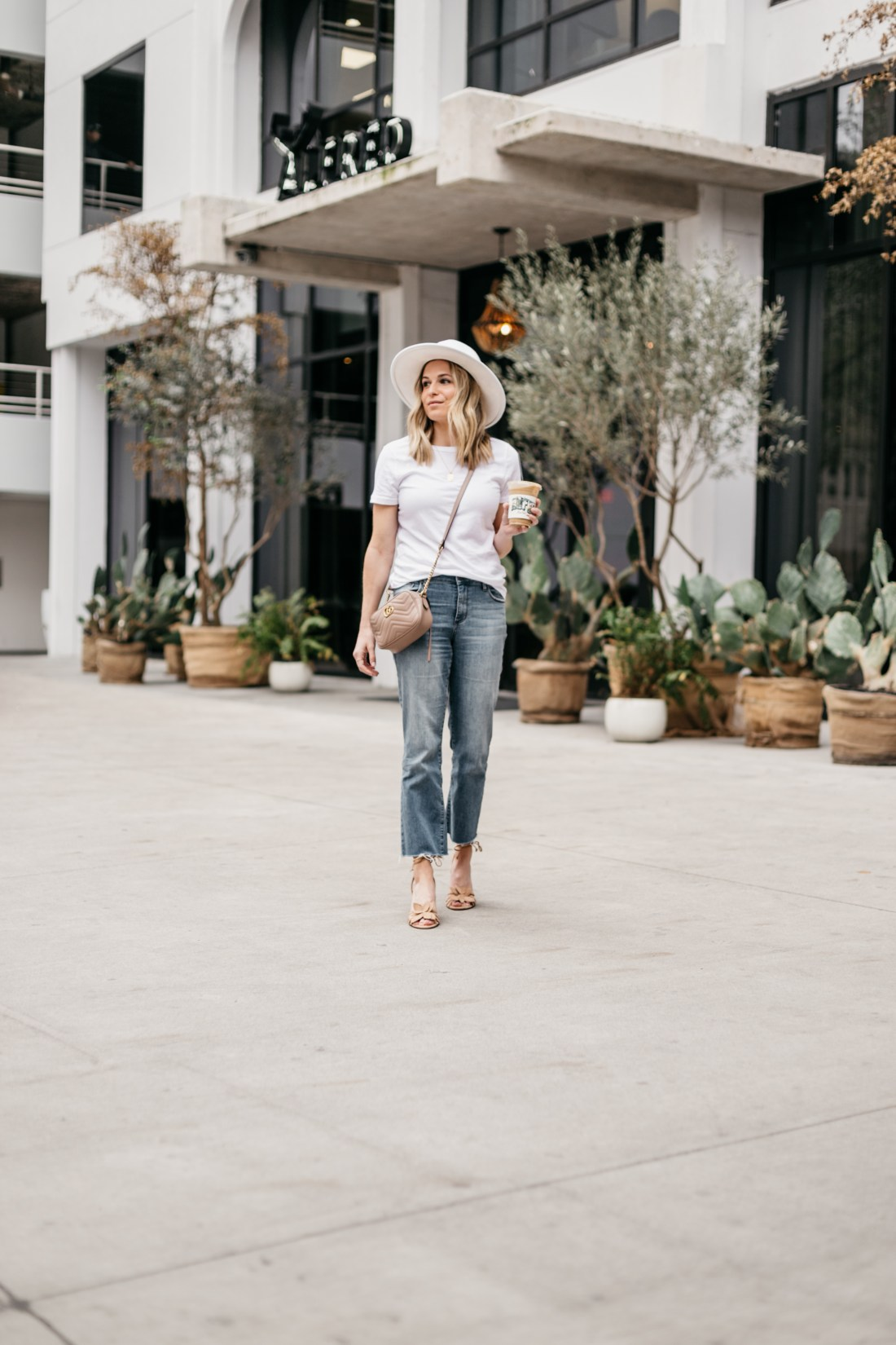 white hat and top, jeans and gucci bag outfit in Austin