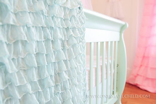 Pretty aqua ruffle crib blanket | See the entire nursery at One Small Child: www.onesmallchild.com