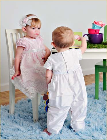 How to Address Sibling Rivalry on Your Baby's Baptism Day