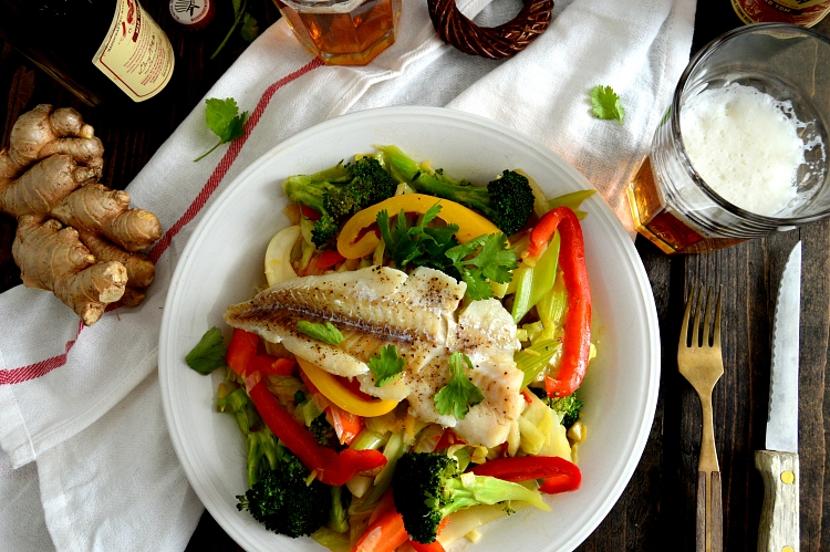 Olive oil poached fish on the bed of  stir fry vegetables