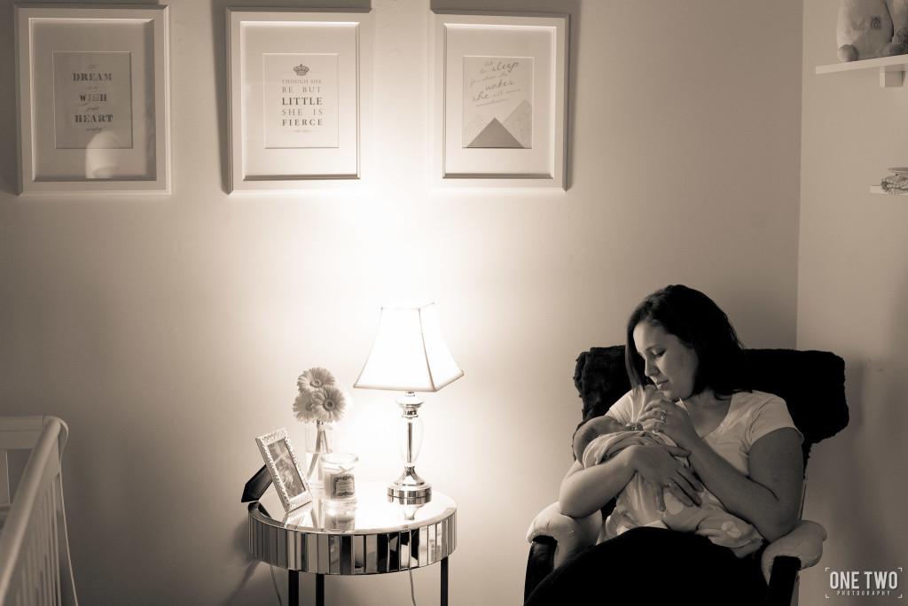 mother nursing baby rocking chair nursery newborn photography