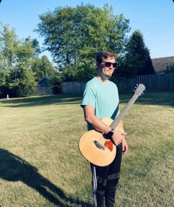 dave wienke with guitar in the yard
