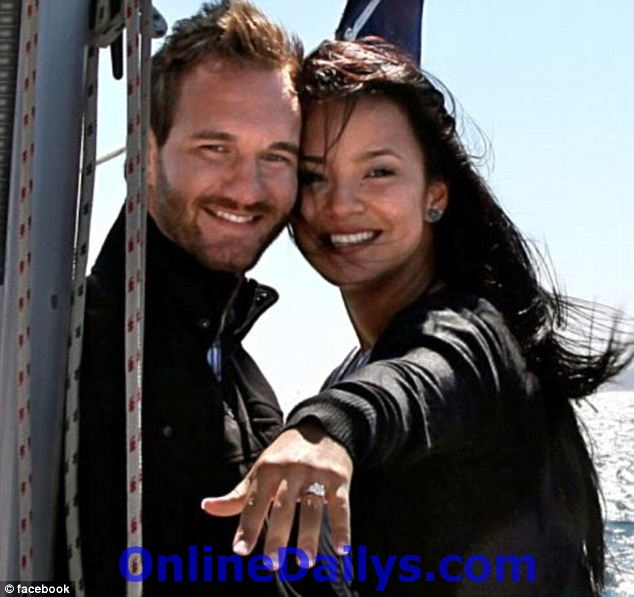 Happily married: Vujicic and his wife Kanae Miyahara met in 2008. In this photo Kanae shows off the ring that Nick placed on her finger with his mouth