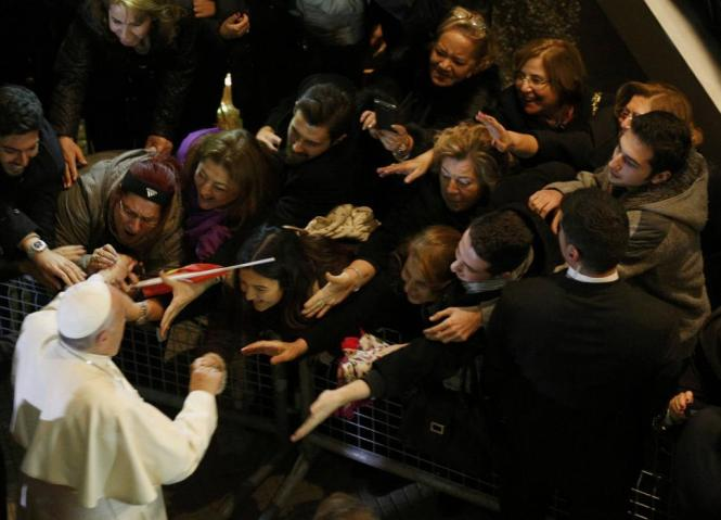 Pope Francis leaves after celebrating a Holy Mass at the Catholic Cathedral of the Holy Spirit in Istanbul