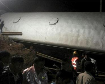Two Passenger Trains traveling in opposite Crush in India