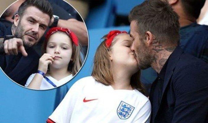 David Beckham kisses daughter Harper