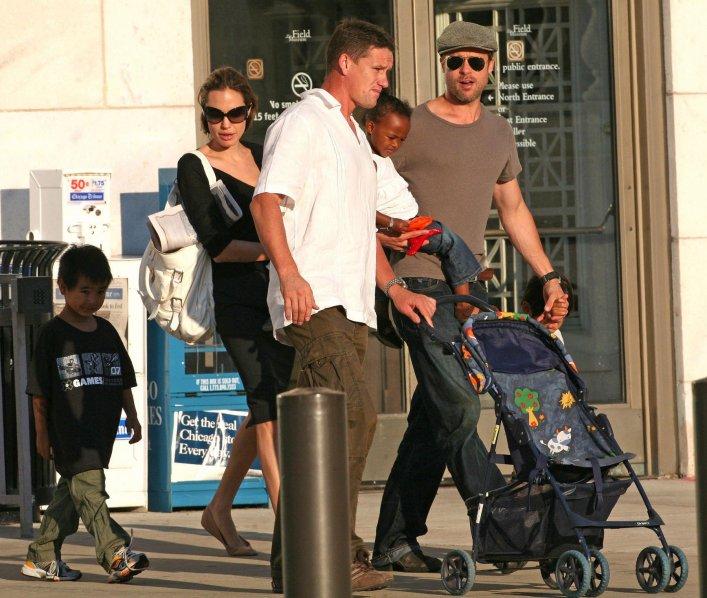 Brad Pitt and Angelina Jolie on a walk with the kids accompanied by Mark Billy Billingham