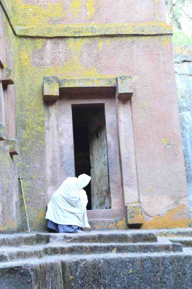 Woman worshiping at Bet Giorgis (not allowed inside)